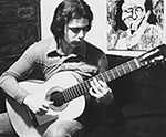 As a teenager, playing a flamenco guitar